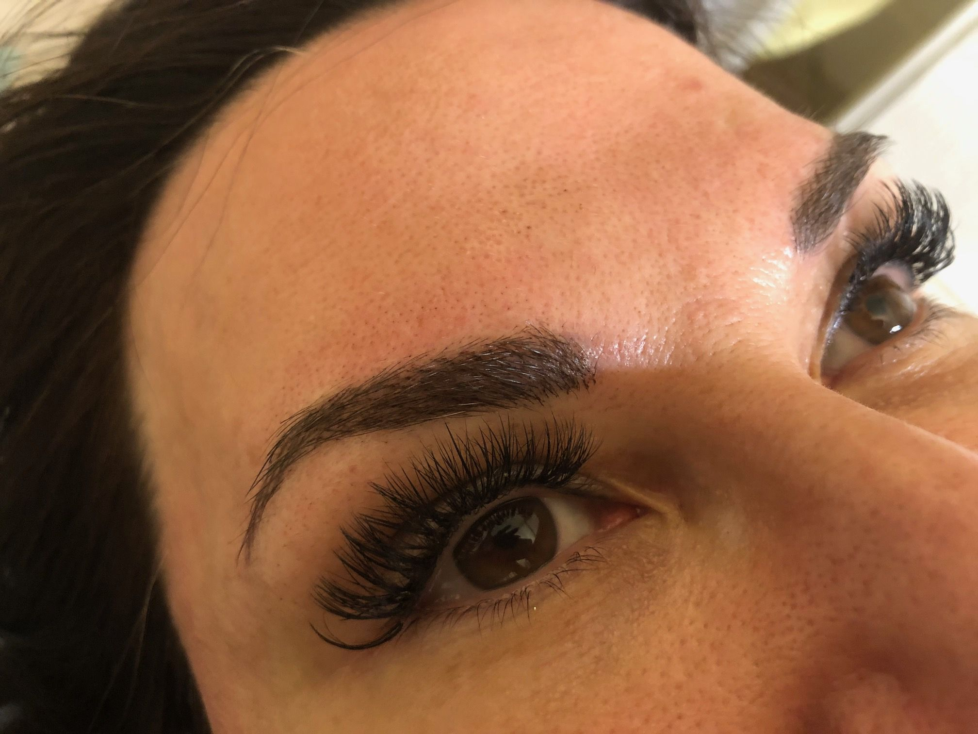 Fine hair strokes used to thicken clients brows